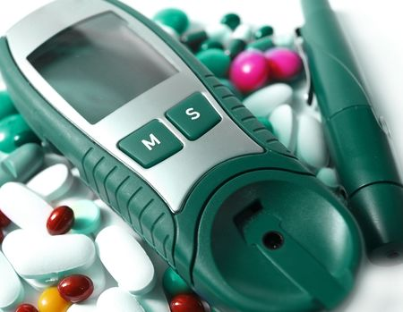 hypoglycemic: Device for measuring blood sugar level and pills Stock Photo