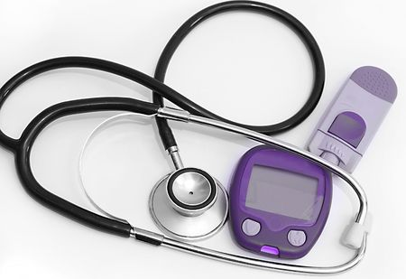 Device for measuring blood sugar level and stethoscope isolated on white background         Stock Photo