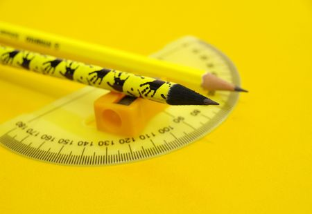 Yellow pencils,sharpener and ruler-educational concept        photo