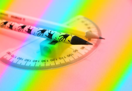 Pencils,sharpener and ruler-educational concept  in rainbow version    photo