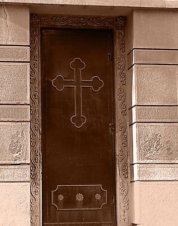 an old vintage  door with cross photo