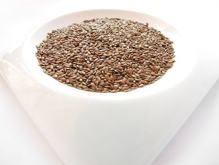 Bowl full of brown flax seed or linseed  photo