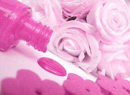 Spilled pink nail polish and rose Stock Photo - 7912776