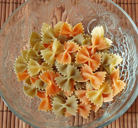colored pasta  placed in glass plate   photo