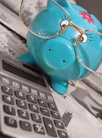 News,calculator, coffee,piggy bank and glasses-business concept     Imagens
