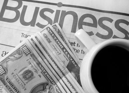 Business concept-newspapers,money and cup of coffee photo