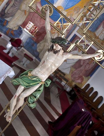 tortured: The cross- symbol of Gods love to people