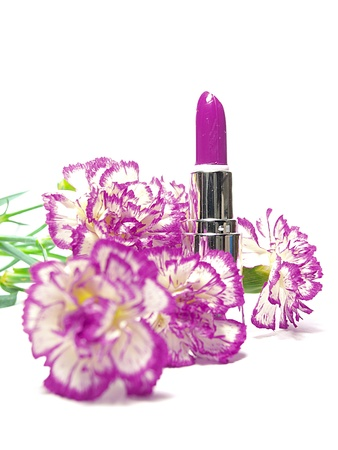 glamor shiny lipstick isolated on white background and flowers  photo