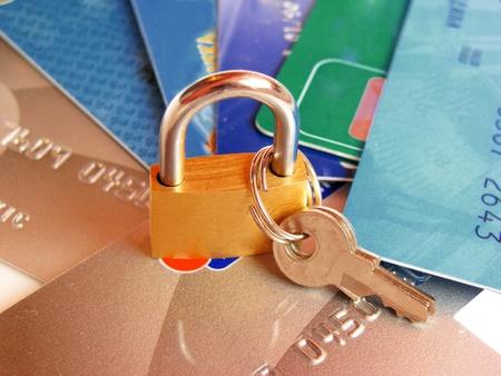 Security: Brass padlock on credit card.  Stock Photo - 9296362