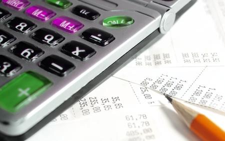 Calculator and bill Stock Photo - 9994095