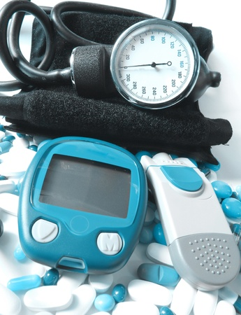 hyperglycemia: Blood pressure device and device for measuring blood sugar level Stock Photo