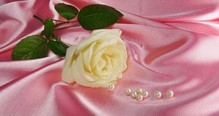 pink satin: rose ans pearls on pink satin