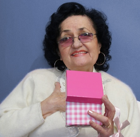 happy smiling excited middle age woman with gifts Stock Photo - 11996911