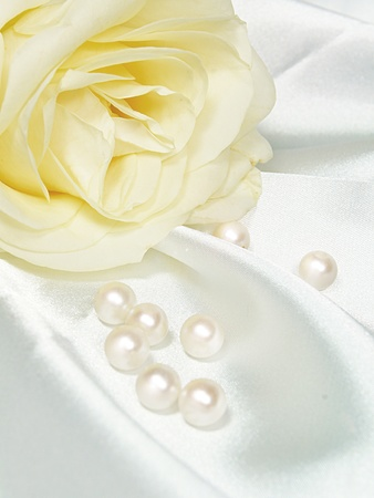 rose and pearls on white satin photo
