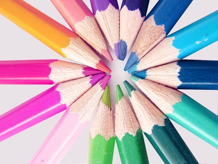Group of pencils in different colors appointed in round shape  photo