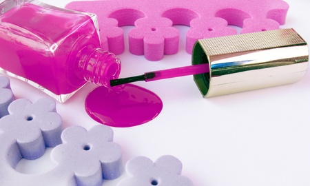 Spilled pink nail polish and accesories  Stock Photo - 12635390