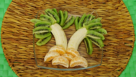 palm tree made of bananas, kiwi and orange photo