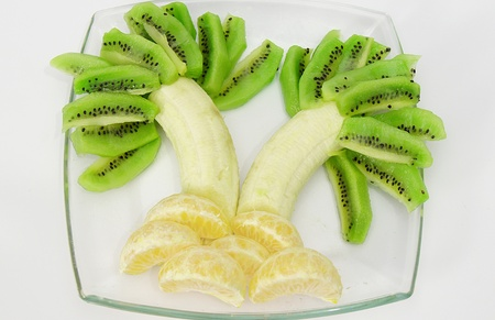 palm tree made of kiwi, orange and bananas photo