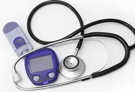 diabetes meter kit: Device for measuring blood sugar level and stethoscope Stock Photo