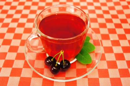 Cup of organic fruit tea with fresh cherry  photo