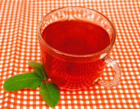 Cup of organic fruit tea  photo