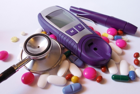 Device for measuring blood sugar level and pills with stethoscope  photo
