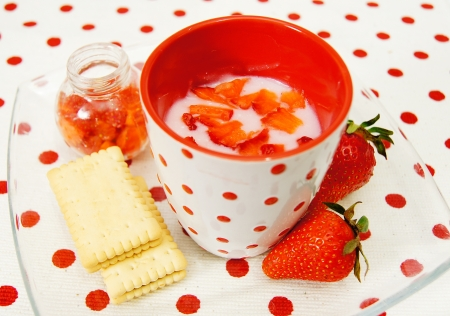 Beautiful strawberries and Strawberry fruit yogurt with cookies photo