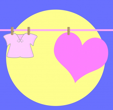 heart drying on a wire , with baby clothe,on a moonlight photo
