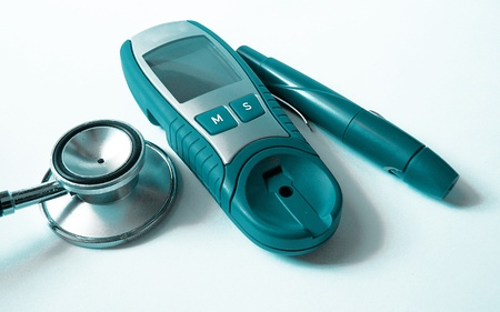 diabetes meter kit: Stethoscope and device for measuring blood sugar level and isolated on white background