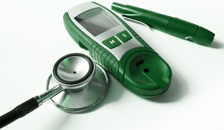 hypoglycemic: Device for measuring blood sugar level and stethoscope        Stock Photo