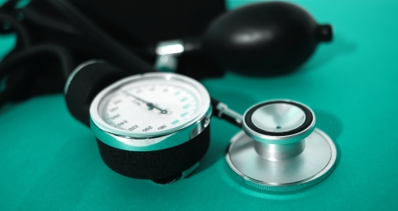 device for measuring blood pressure level isolated on green background photo