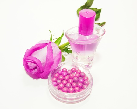 Perfume and makeup with flower photo