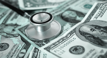 health care costs - Stethoscope on money photo