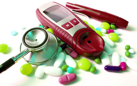 diabetes meter kit: stethoscope,pills and device for measuring blood sugar level Stock Photo