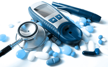 hypoglycemic: stethoscope,pills and device for measuring blood sugar level Stock Photo