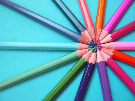 pencils of different colors placed in round shape photo