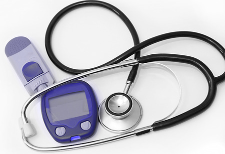 diabetes meter kit: Stethoscope and device for measuring blood sugar level and isolated on white background Stock Photo
