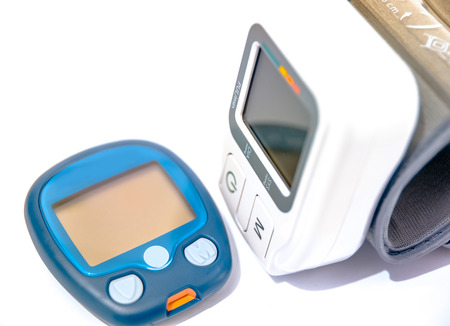 hypoglycemic: Blood pressure device and device for measuring blood sugar level Stock Photo