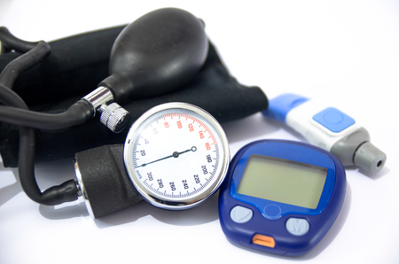 Blood pressure device and device for measuring blood sugar level Stock Photo