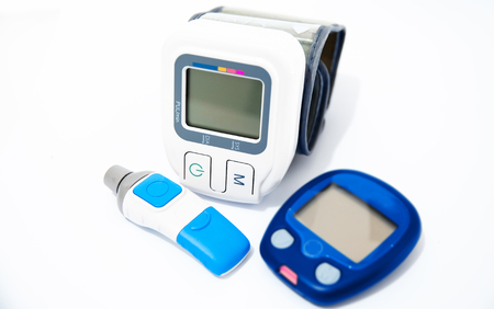 presure: Blood pressure device and device for measuring blood sugar level Stock Photo