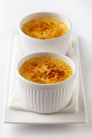 Creme brulee French vanilla cream dessert with caramelised sugar on top  photo