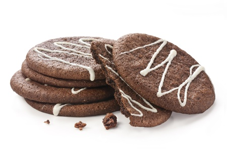 chocolate cookies on white background with white icing decoration