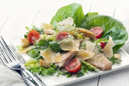 worcestershire: Caesar Salad in transparent bowl Stock Photo