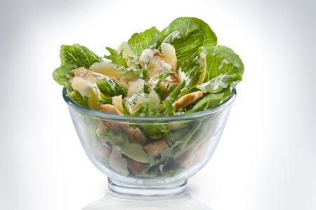 CHICKEN CAESAR SALAD: Caesar Salad in transparent bowl Stock Photo