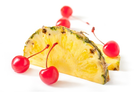 Pineapple Cross Section Slices with Maraschino Cherry with stem On White
