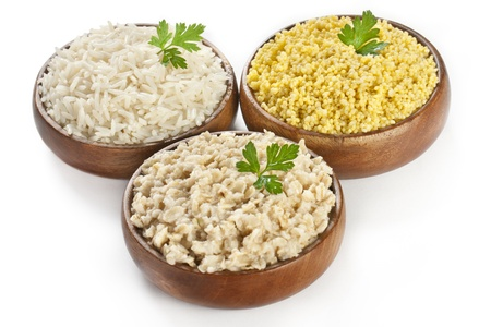 kasha: Bowls of cooked cereal  porridge kasha - healthy cereal eating from rice, oatmeal porridge and millet (couscous)