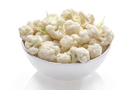 cauliflower in bowl on white isolated 写真素材