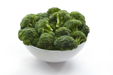 Broccoli in bowl on white isolated 版權商用圖片