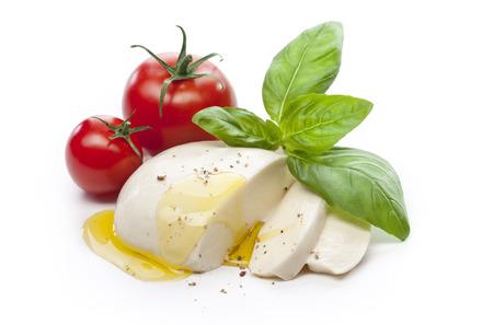 mozzarella cheese: Mozzarella with tomatos and basil leaves isolated