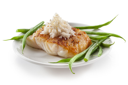 haricot vert: cod fish with vegetables green beans and rice Stock Photo